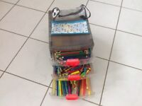 3 drawer box filled with pens and crayons