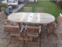 Solid teak table and 6 chairs by bramblecrest. Cost £2000 sell for £400 Ono