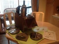 Cuoco commercial vegetable cutter with blades and instructions . To collect