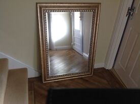 Large gold framed mirror, ideal for dining room.