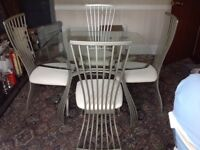 Glass Dining Room Suite Table and 4 matching Chairs