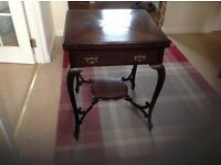 Edwardian mahogany envelope card table with original green baize , cabriole legs and blind fretwork.