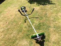 Long reach petrol 2stroke grass strimmer. Steel blades 9000min rotary. Handles for easy use.