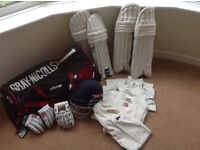 Young adult cricket kit and equipment.