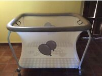 Play pen never used and still in box. Neutral white/beige design.