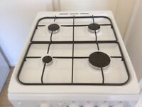 White Indesit Free Standing Gas Cooker 50cm, electric ignition, flexible gas hose fitted