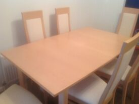 John Coyle dining table with six chairs