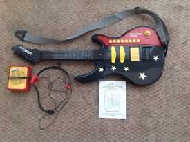 STARSOUNDS Electronic Amplified Guitar with Singalong Head Microphone and Speaker Box. For age 6.