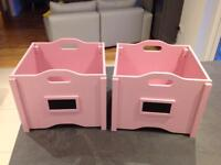 A pair of children's storage boxes
