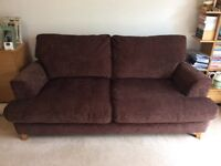 Brown sofa and footstool