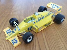 An Ayrton Senna Lotus F 1 model car by Burago 1 24 scale