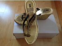 BRand new, size 7 gold Leather Sandals by Zerimar