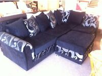 EXCELLENT CONDITION! AS NEW Black corner sofa settee with foot rest patterned cushions and base