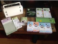 Cricut electronic cutter including carry case, 4 cartridges, paper, tools board and much more.