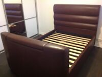 Dreams brown faux leather double TV bed frame for sale.