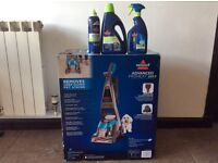 New Bissell Advanced Proheat pet Carpet cleaner and three cleaning fluids.