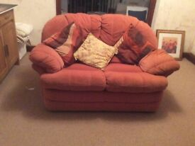 Two 2 seater sofas and matching arm chair. Terracotta valour. In good condintion.