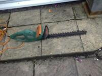 Electric hedge cutter. As new. 500 watt. Good size.