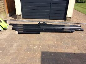 Building materials including downpipes and guttering in black. Surplus to requirements