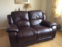 Leather reclining two seater sofa