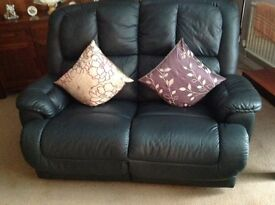 Leather chair and settee.