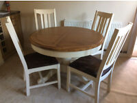Dining Table and 4 chairs. Nearly new, hardly ever used and in excellent condition.