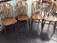 A Real Vintage Gem Set of four Ercol Wheel-back chairs