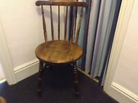 Attractive solid wooden chair. Dark wood.