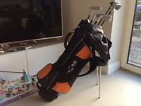 Children's golf bag and 5 clubs plus 20 balls