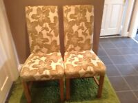 Two green fabric dining room chairs