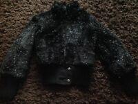 Girls black with silver flecks fur jacket 11-12 years