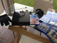Sony PS4 Bundle with 2 controllers Charging Station & 9 games