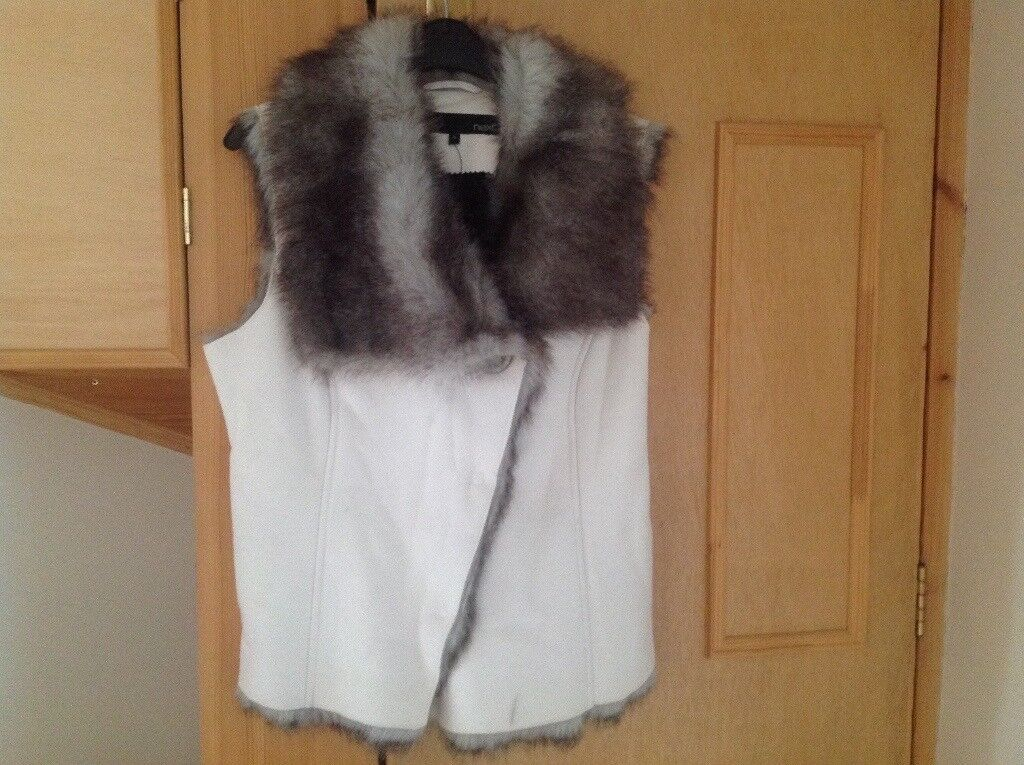 Ladies cream body warmer. NEXT. Size 10. New unwanted gift. Faux fur lining. Faux suede.
