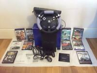 Sony PS2 bundle still in original box with games, steering wheel and pedals