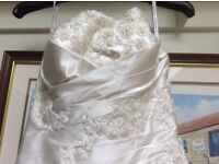 Stunning oyster wedding dress. Size 8/10. Complete with underskirts and veil.