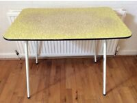 1950s yellow Formica topped kitchen table with black abstract design.