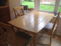 Pine colour dining table and 4 chairs