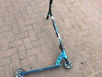 Blue nitro extreme scooter with stunt pegs