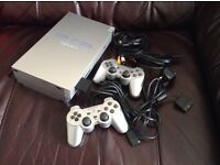 PS2 with 2 controllers and 11 games