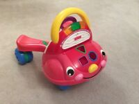 Fisher price walker / sit and ride.
