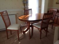 Solid wood oval dining table, four chairs and sideboard