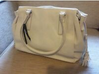 White, leather handbag. Brand new with label. Two handles. Three pockets.