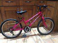 Girls pink bike for sale. Will suit 6 to 11 year old.
