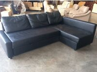 Black chaise sofa/bed with storage
