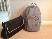 Grey backpack changing bag and black boots changing bags.