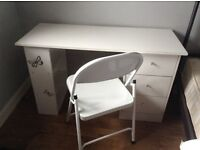 White desk with folding white chair