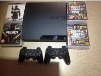 PS3 Console, 2 controllers plus games
