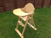 Wooden highchair with table.