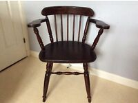 Antique wooden captain's chair in good condition