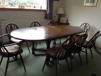 Ercol dining table and eight chairs